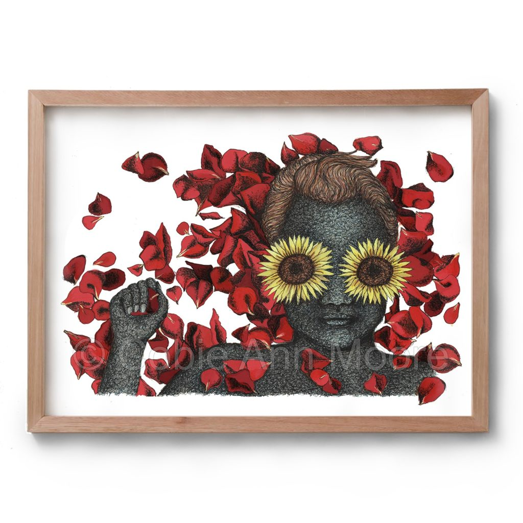 Drawing by Cobie Ann Moore of a woman with blue skin and sunflowers over her eyes, the woman has a rose petal in her hand and is surrounded by red rose petals. The artwork is framed in a simple wooden frame