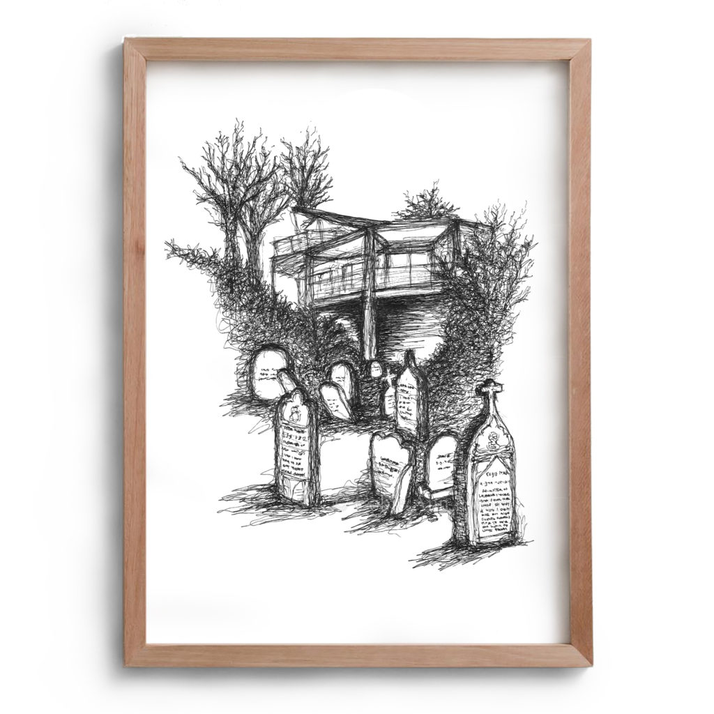 Black and white drawing by Cobie Ann Moore of a graveyard with a house and some trees in the background. The artwork is framed in a simple wooden frame