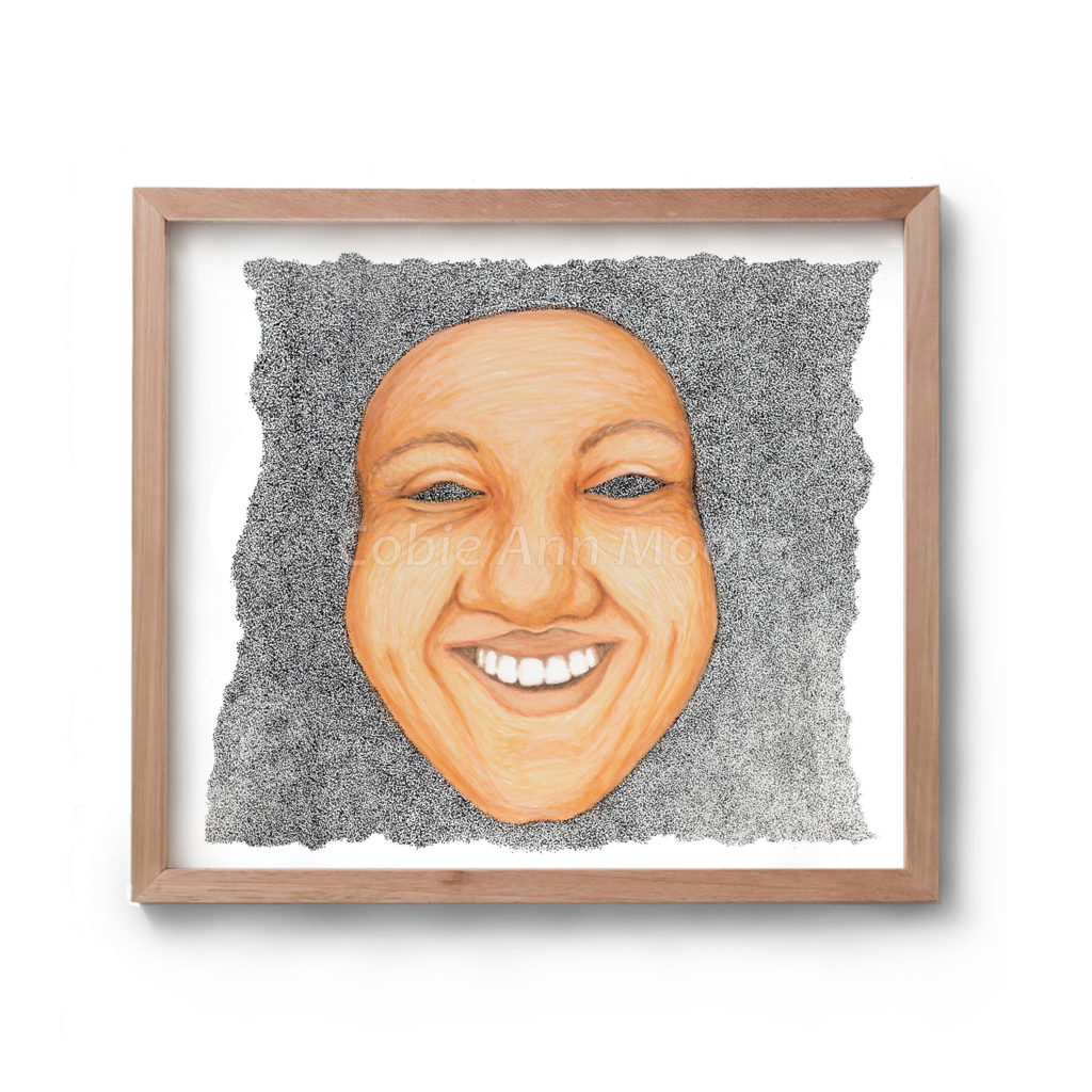 Drawing by Cobie Ann Moore of a mask of a very happy female face. Framed in a simple wooden frame
