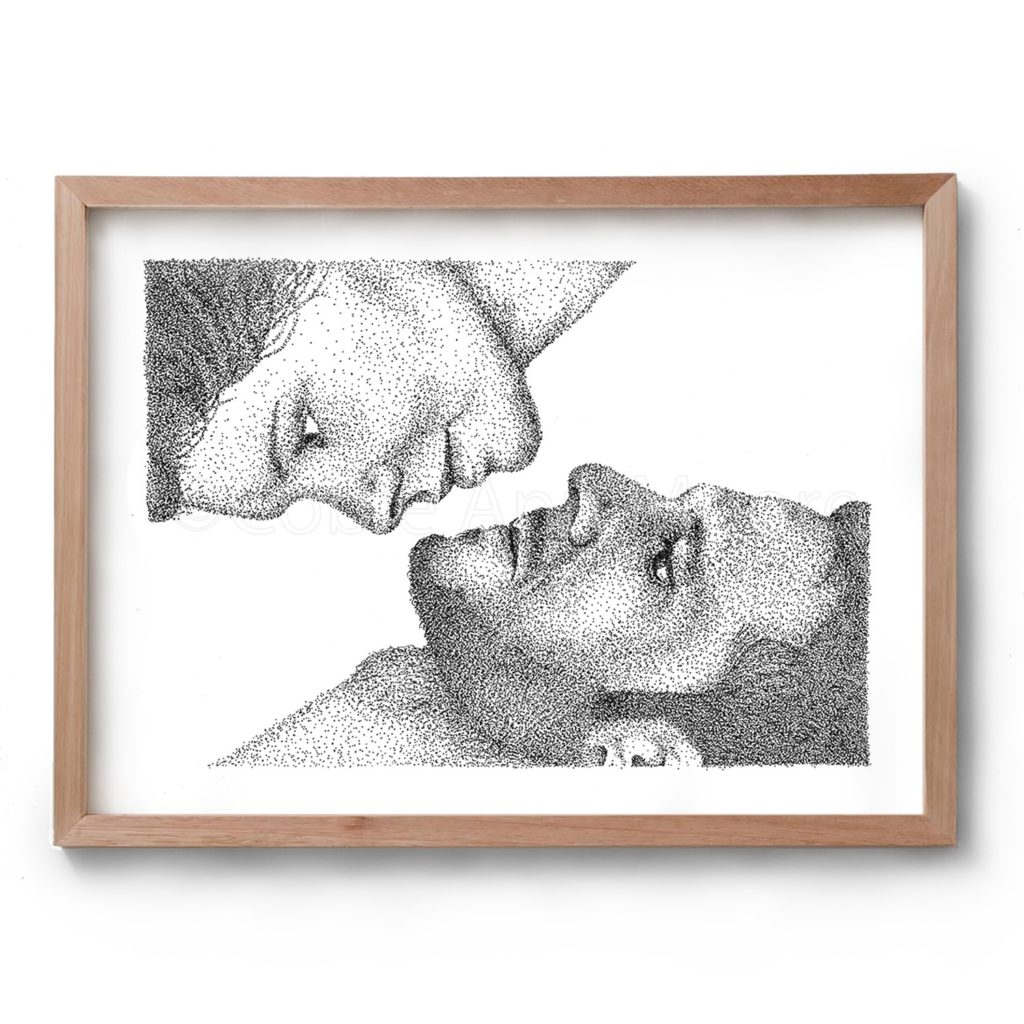 Black and white artwork by Cobie Ann Moore of two faces, a woman in the top left hand corner and a man in the bottom right hand corner, drawn with the stippling technique. Framed in a simple wooden frame