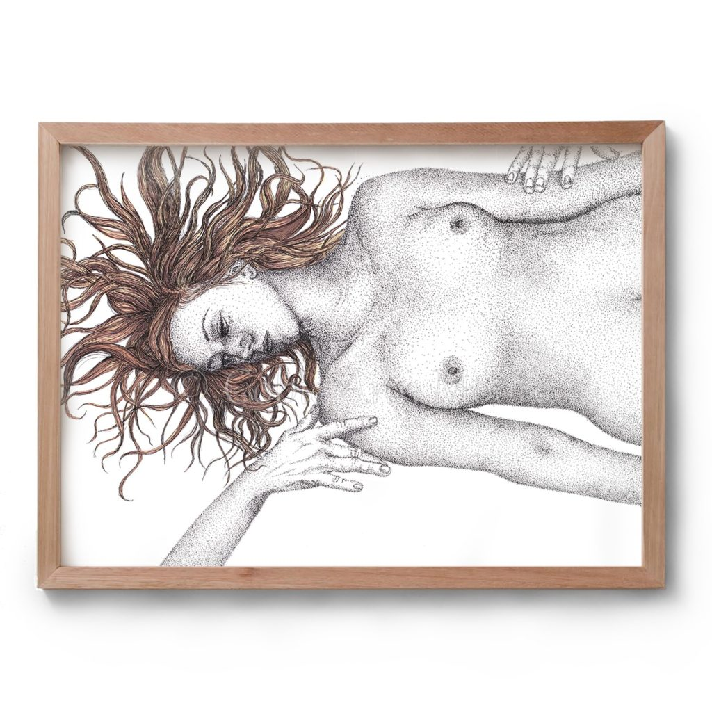 Drawing by Cobie Ann Moore of a naked woman laying flat on her back with her hair splayed out. Two hands reach in to touch the woman from beyond the frame. The drawing is in black and white except for the hair which is brown. The drawing is framed in a wooden frame.